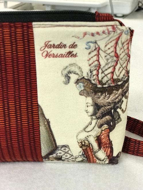 Marie Antoinette zipper cosmetic wristlet
