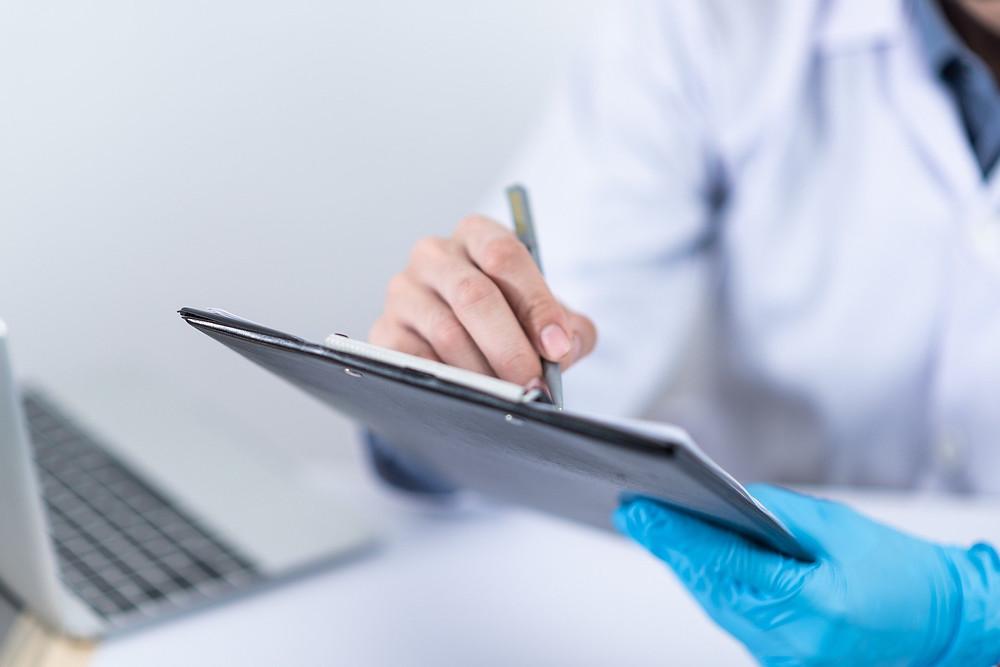 BUPA visa health service Nurse filling out COVID-19 questionnaire in Australia