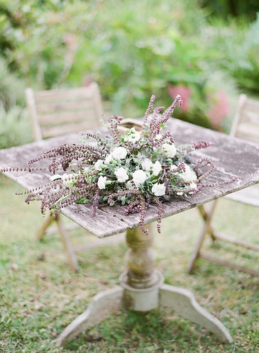 A bouquet on a wooden garden table