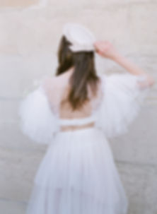 Bride's back wearing a Tulle Wedding Gown