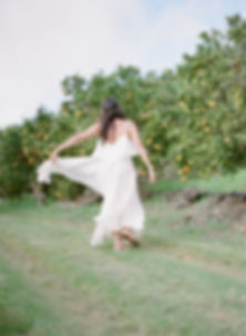 Girl dancing in a citrus fruits