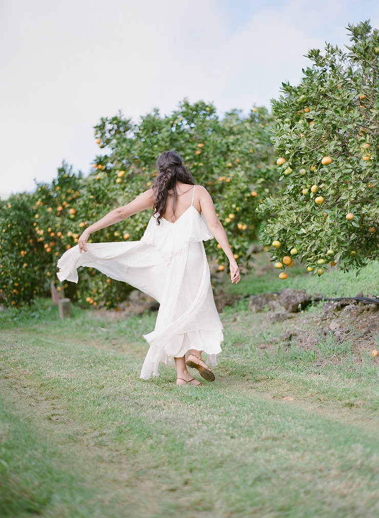 Girl dancing in a citrus fruits