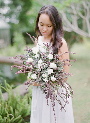 Pretty girl holding and looking at her bouquet