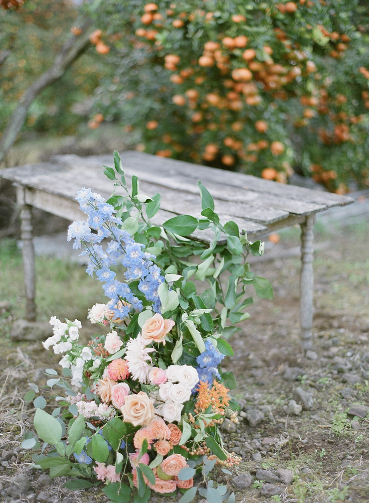 Wood table with a floral arrangement in front