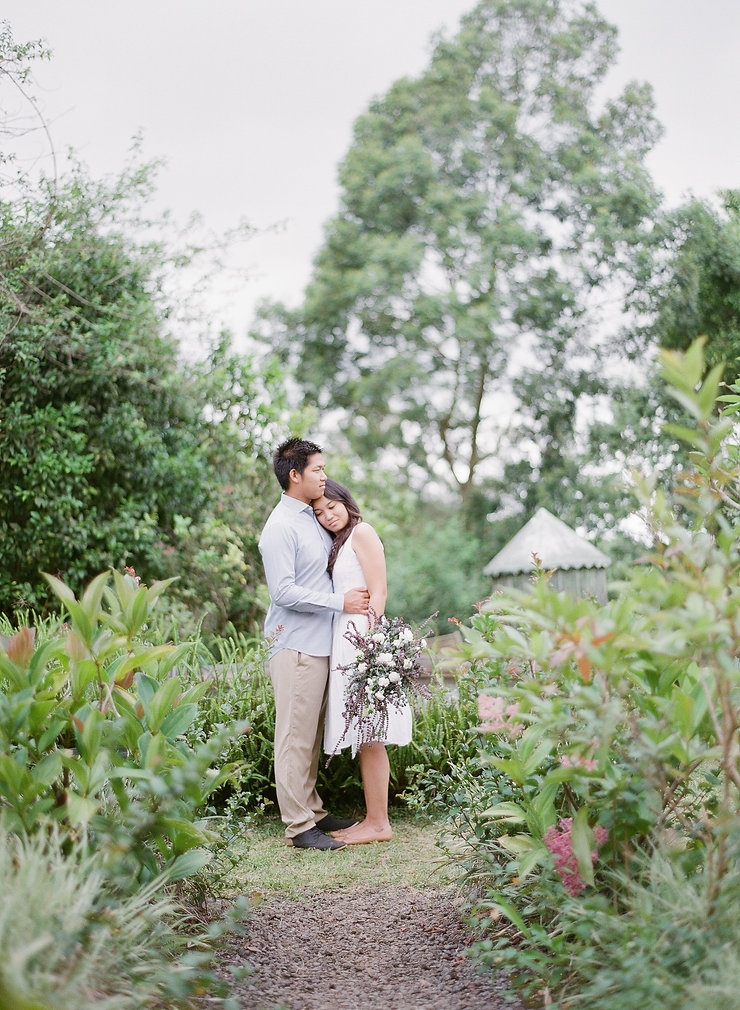 A lovely couple standing on a garden