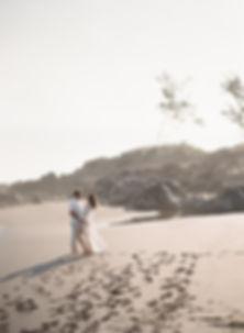 Couple on a black sand beach