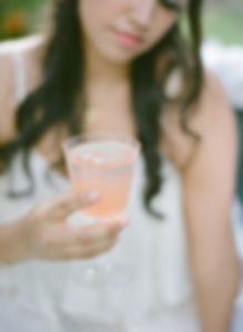 Bride holding a cocktail glass