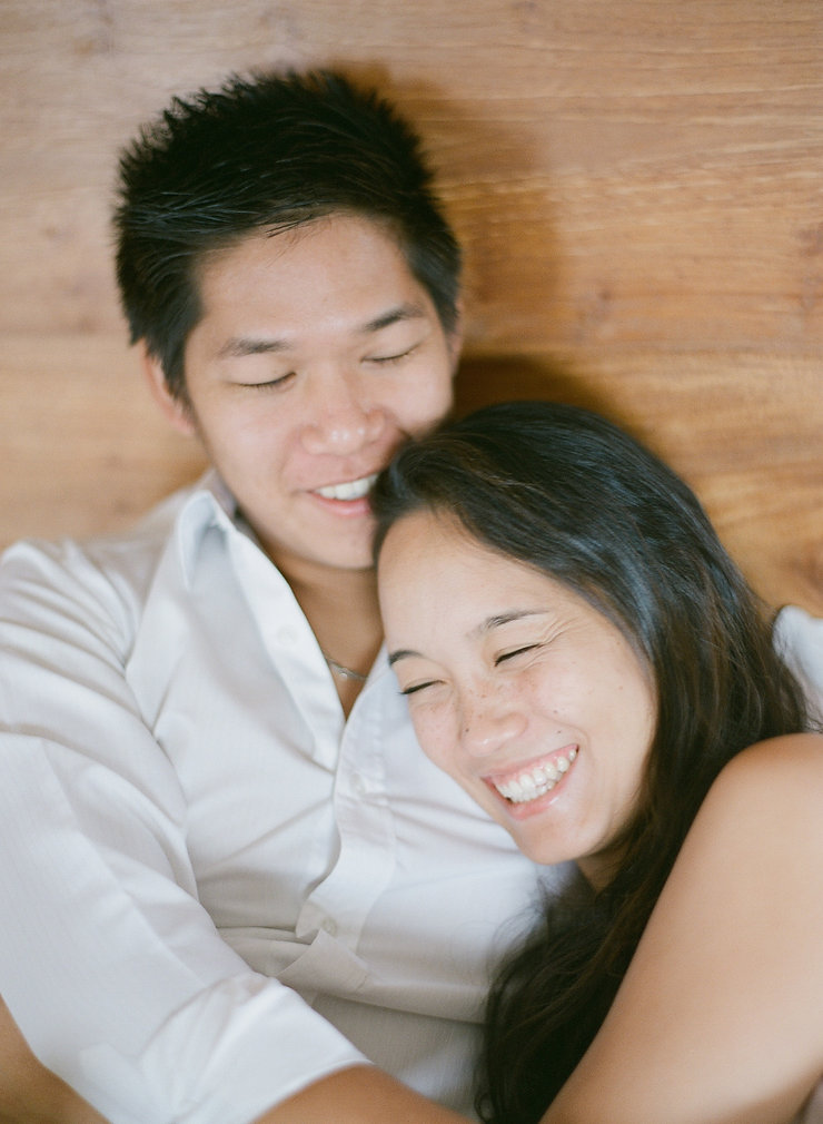 Close-up on a smiling couple on bed
