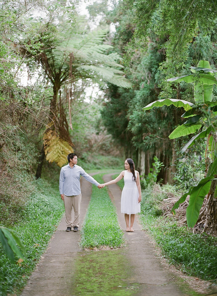 Pretty girl and boyfriend side by side in a pathway
