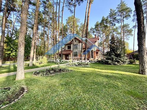 Продажа дома в сосновом лесу.