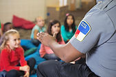 officer talking to children with new communication skills learned from mckenziecounseling.org