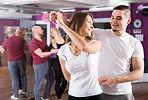 Happy young people having waltz dancing