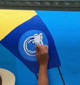 Artscape Logo being painted