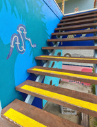 Artwork next to the stairs