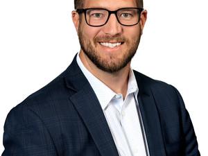 Adam Emshwiller named Partner