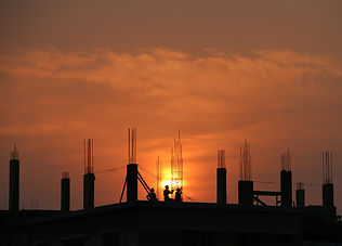 silhouette-of-men-in-construction-site-d
