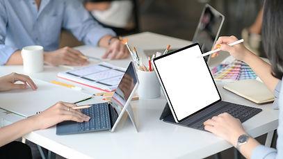 graphic-designer-team-uses-laptops-to-de