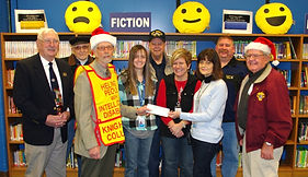 Knights of Columbus members from left, Frank Subasic, Tom Darroch, Ernie Ziemba, Skip Price, Ben Breeze and Frank Kucharski present a check for $550.00 to Special Ed coordinator, Casey Lebo-Dunn, Principal, Michelle Gest, and Special Ed teacher Cindy Pennesi at Hancock Elementary School.