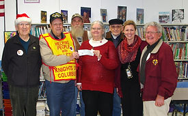 Knights of Columbus members from left, Frank Subasic, Tom Darroch, Ernie Ziemba, Skip Price, Ben Breeze and Frank Kucharski present a check for $550.00 to Special Ed coordinator, Casey Lebo-Dunn, Principal, Michelle Gest, and Special Ed teacher Cindy Pennesi at Hancock Elementary School