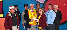 Tuscarora Elementary School Special Ed teacher Melanie Holloman and Principal Tyler Long receives a check for $1000.00 from Knight of Columbus Frank Subasic as fellow Knights Frank Kucharski, Tom Darroch, Skipper Price, Bob Hartwick and Don Bozanic look on.