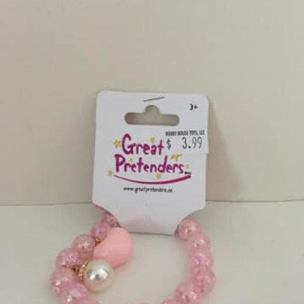 Great Pretenders, pink bracelet