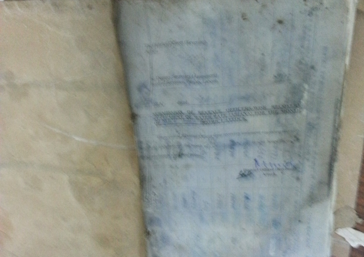 Some illegible tax collection files from a flooded basement of Board of Revenue's Record Room
