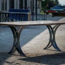 Walnut dining table with custom metal base