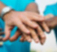 team-volunteers-stacking-hands_53876-307
