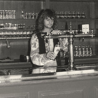 Ronald, the gypsy brewer tapping a beer in the bar of the brewery.