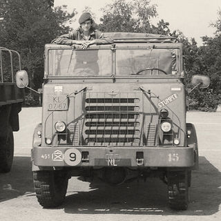 Ronald in the army in Holland, driving a truck.
