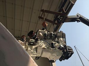 Reachfork lifting a new marine diesel motor into a 65 foot catamaran.
