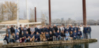 Team photo of employees at on a dock.