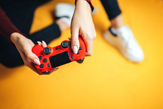 young-woman-playing-with-two-gamepads-on