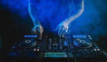 closeup-dj-working-blue-light.jpg