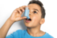 bigstock-A-Black-Boy-Using-An-Asthma-In-