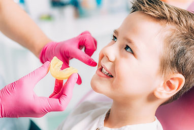 bigstock-Orthodontist-Working-With-Litt-