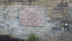 Storks and Flowers in Red Sandstone