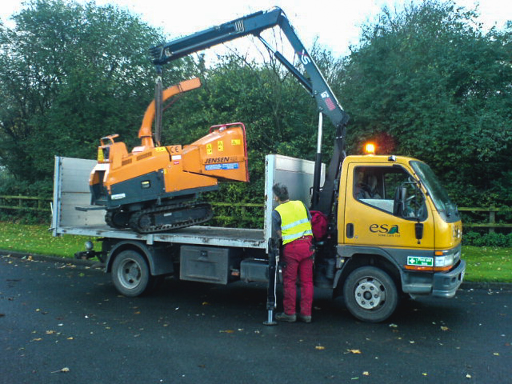 Unloading tracked chipper