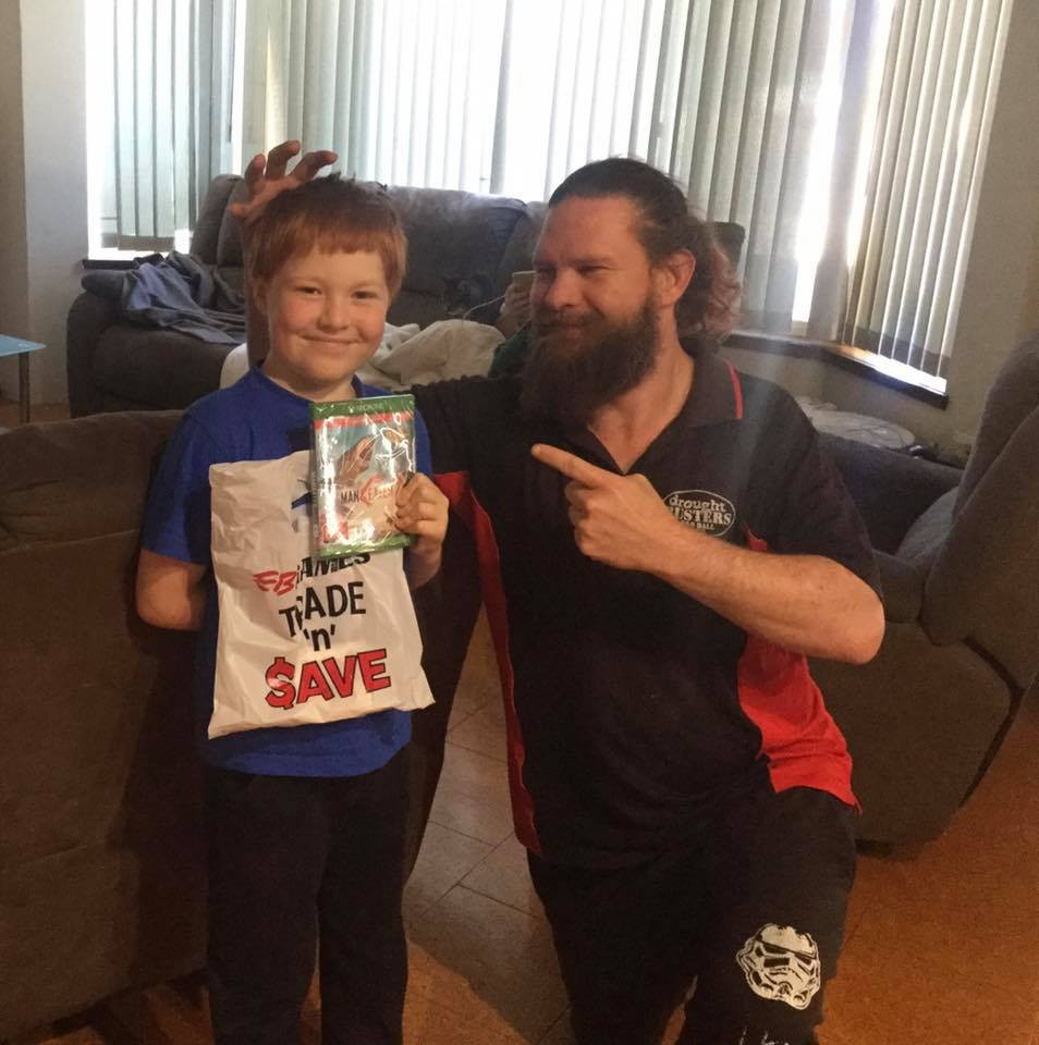 Aaron James Rodgers and his Son with a Copy of ManEaters!