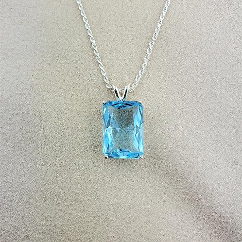 Blue Topaz Emerald Cut Solitaire Silver Pendant