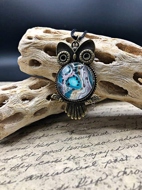 Bronze Owl pendant with Teal, white and multi colored acrylic painted center.