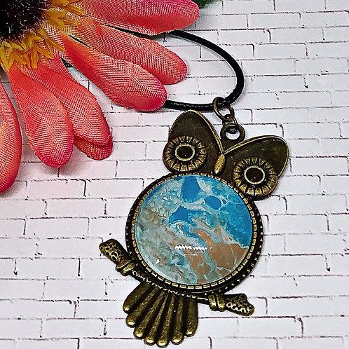 Beach color owl pendant.