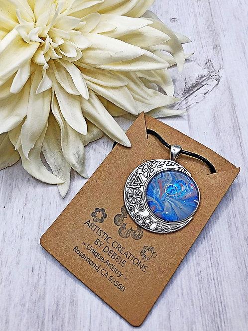 Blue celtic moon pendant.