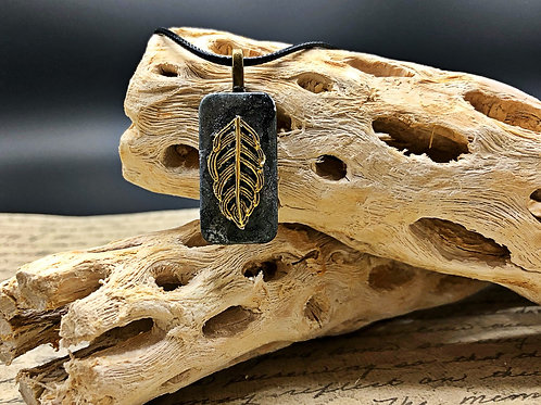 Altered domino pendant.  Gray and silver alcohol ink background with gold leaf adhered to front.