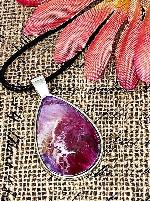 Purple teardrop earring.