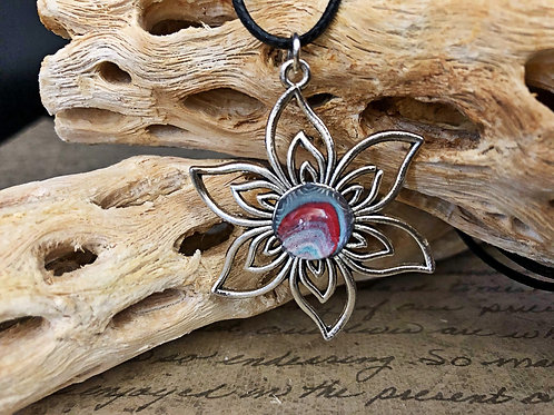 Silver flower pendant with blue, white and red acrylic painted center.