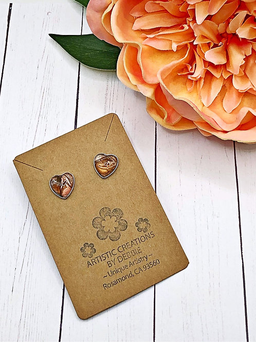 Brown heart earrings.