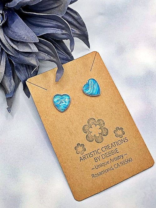 Teal color heart earrings.