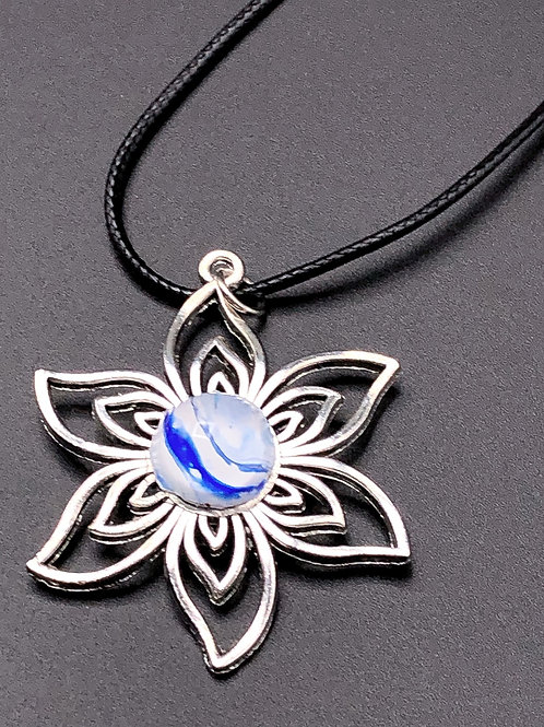 Silver flower pendant with blue and white acrylic painted center.