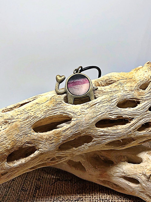 """Copper, pinkish with a tad black  """"love"""" elephant pendant"""